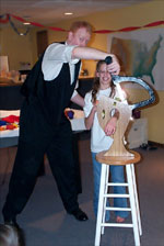 Magician Scott Henderson performing the SCARY Arm Chopper magic trick at a birthday party in Overland Park, KS